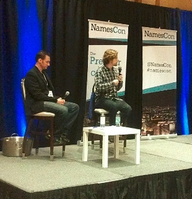Matt Mullenweg (right) speaking at NamesCon.