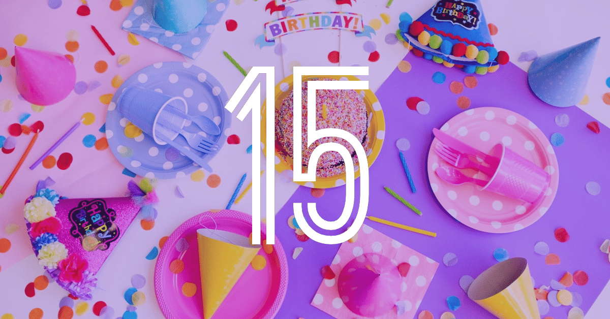 The number 15 overlayed over birthday items including a cupcake, hat and plates