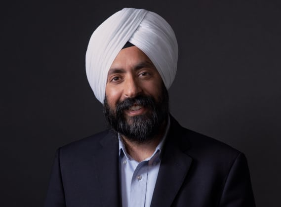 Headshot photo of Aman Bhutani, CEO of GoDaddy