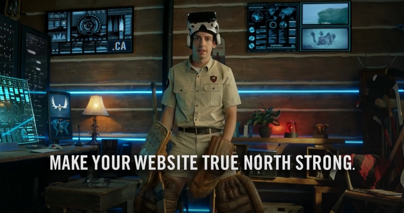 Still from a TV commercial for .ca domains shows a Mountie officer with hockey gear and a virtual reality headset