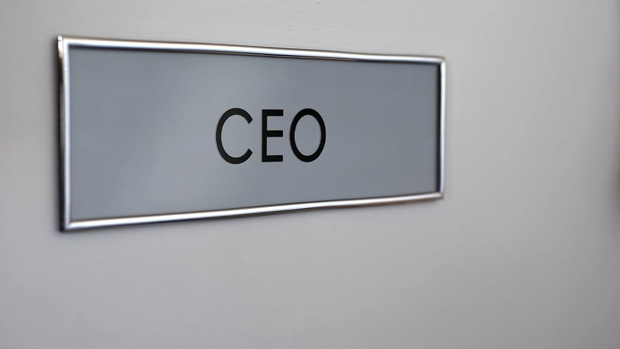 "Picture of a door with a ""CEO"" nameplate in gray"