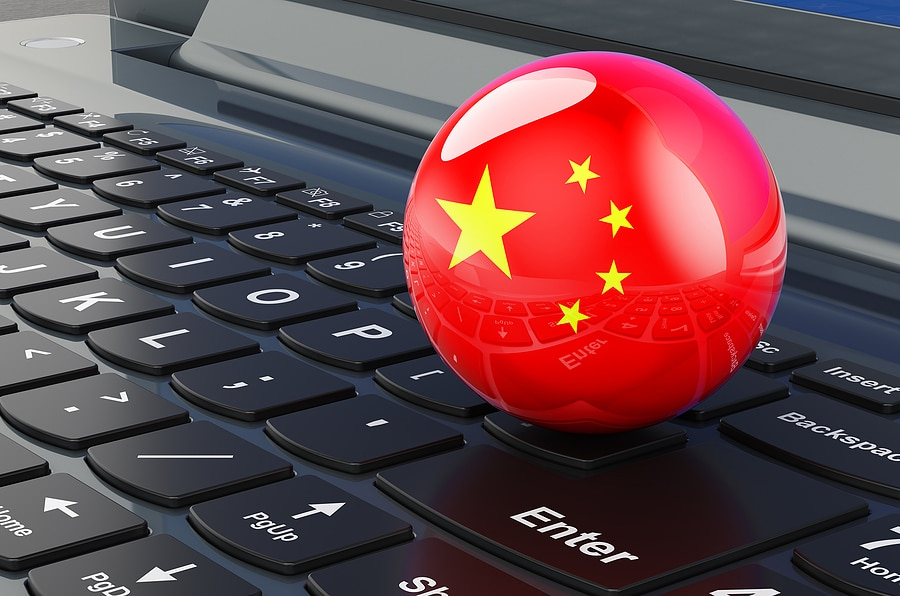Picture of a laptop computer with a red ball with the Chinese emblem on it