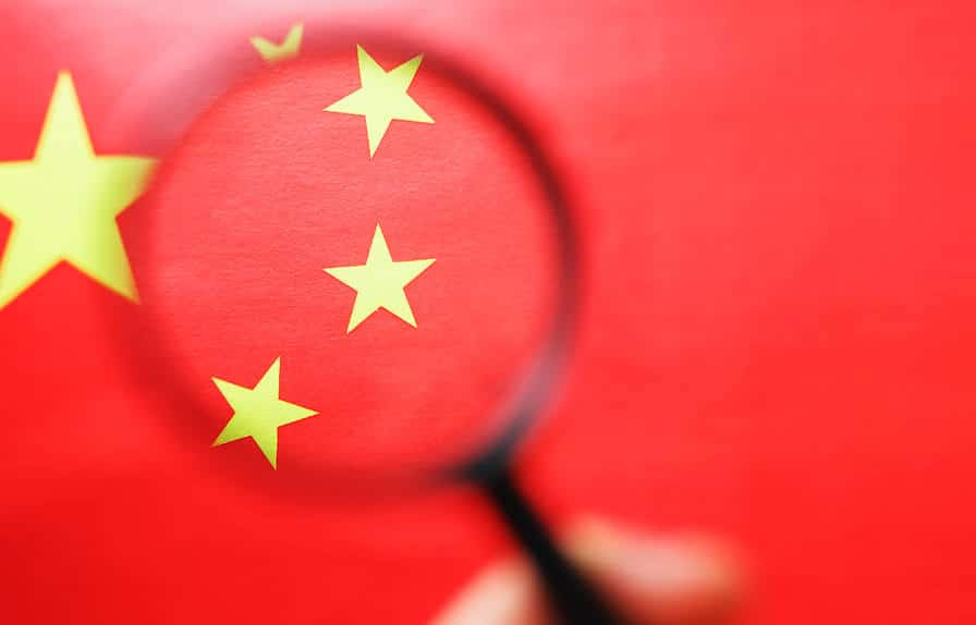 Magnifying glass over Chinese flag