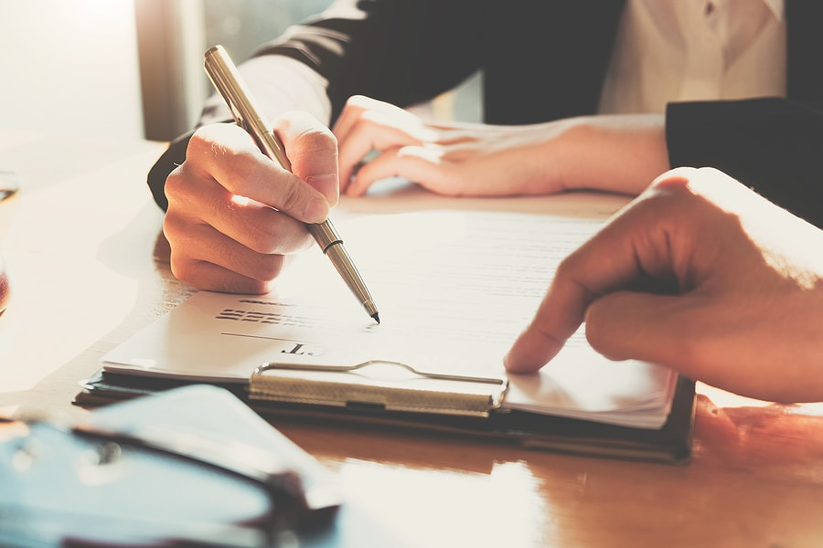 Picture of person signing a contract