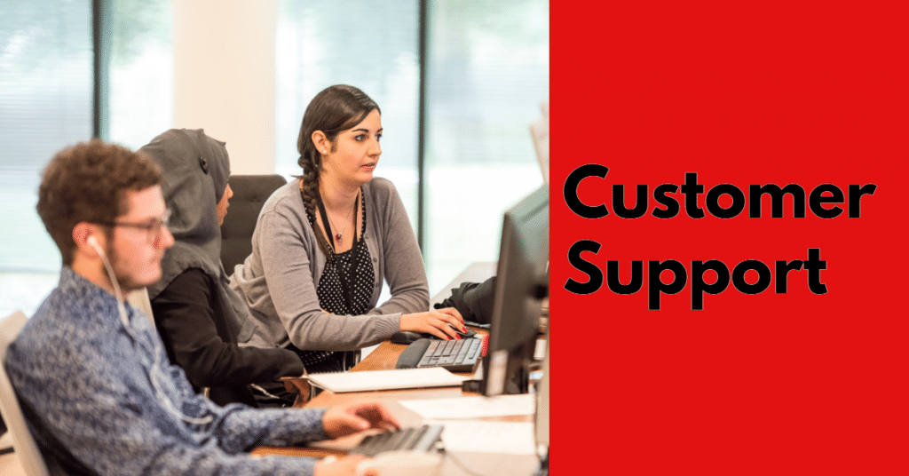 "Picture of customer support representatives in a call center with ""Customer support"" in black text on a red background"