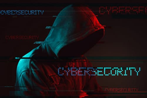 Image of man in black hoodie on black background with the word cybersecurity