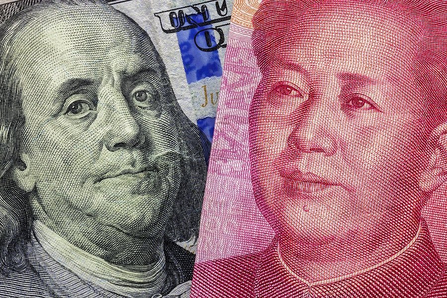 hundred dollar bill with ben franklin and 100 Yaun bill with Mao Tse-tung