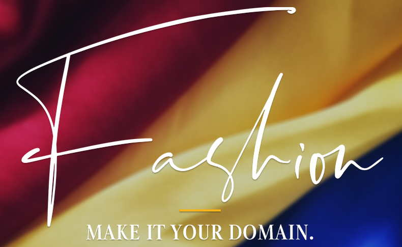 "the word ""fashion"" with ""Make it your domain"" below on a background of red, gold and blue fabric"