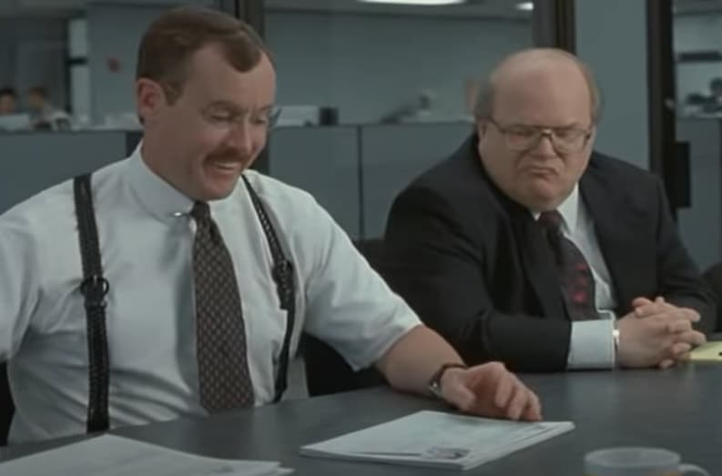 "A screenshot from Office Space movie ""We fixed the glitch"""