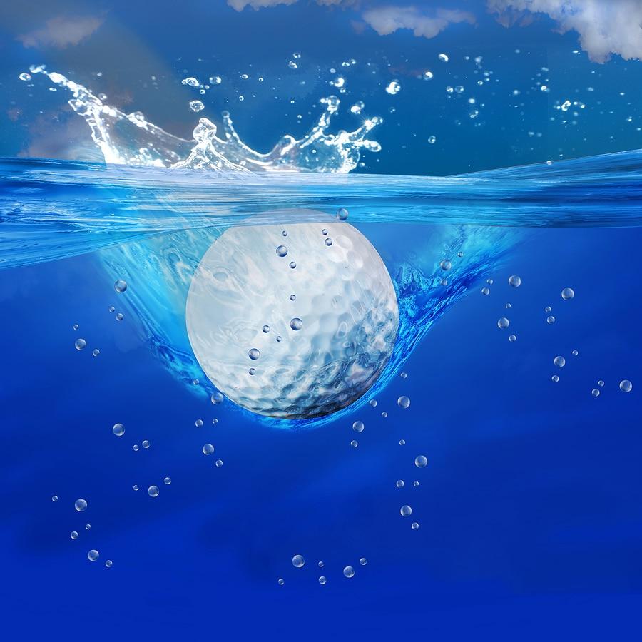 golf water hazard ball falling into water