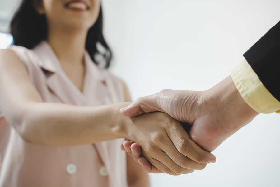 Picture of man's hand shaking hands with woman