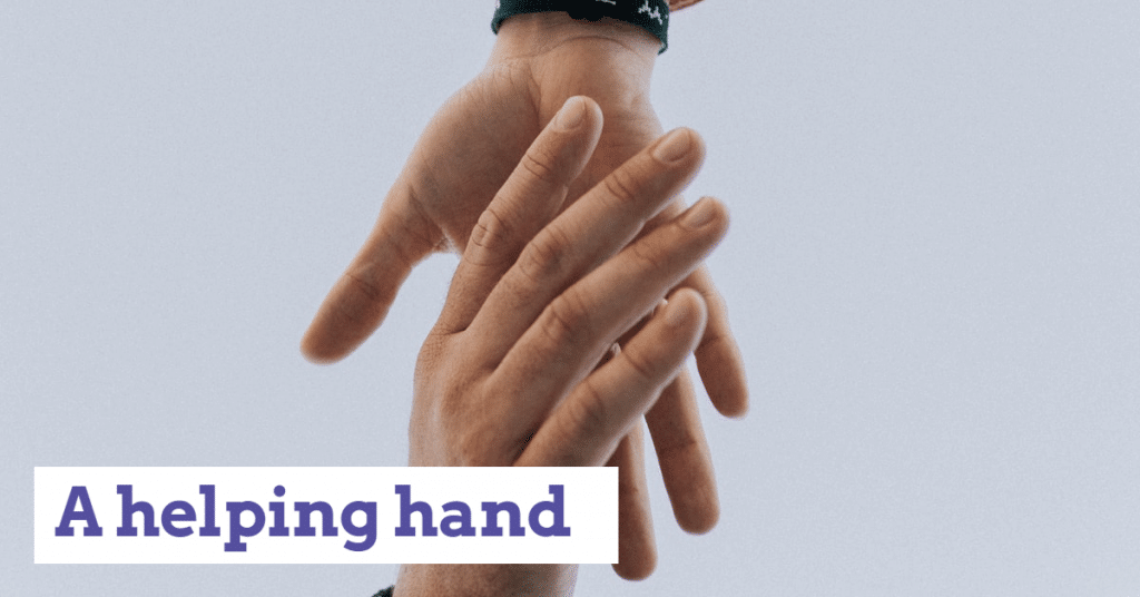 "Two hands joining together with the words ""A helping hand"""