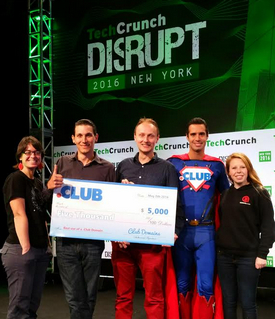 Homecookers.club accepts its prize at the TechCrunch Disrupt NY Hackathon.