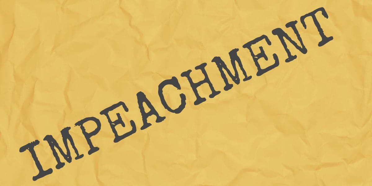 The word Impeachment on a yellow background