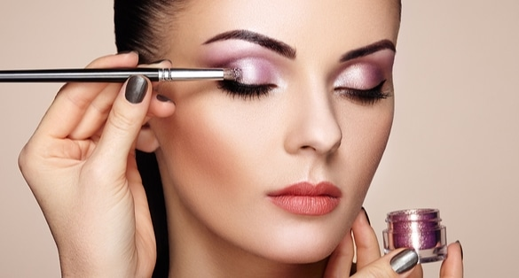 Picture of woman applying eye shadow