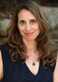 Headshot of Mina Neuberg, CMO of Donuts