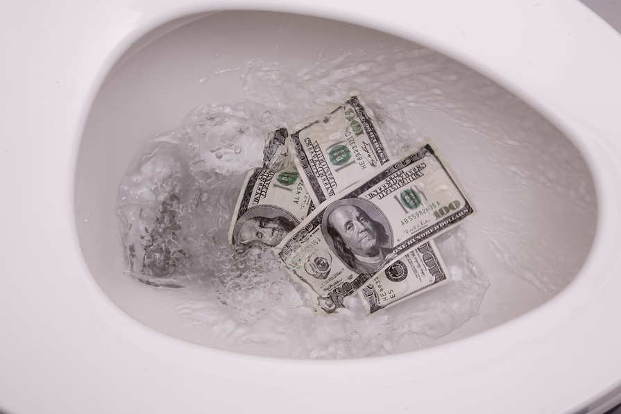Picture of hundred dollar bills being flushed down the toilet