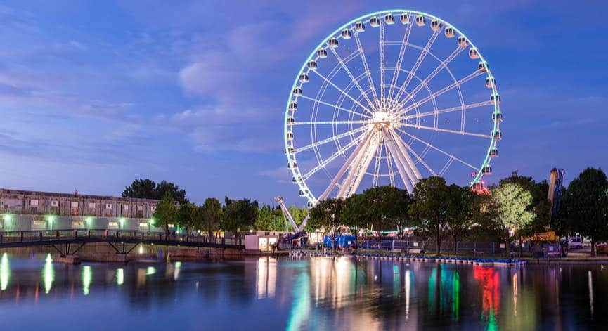 Picture of Ferris Wheel in Montreal, Canada at dusk, with reflection in the water