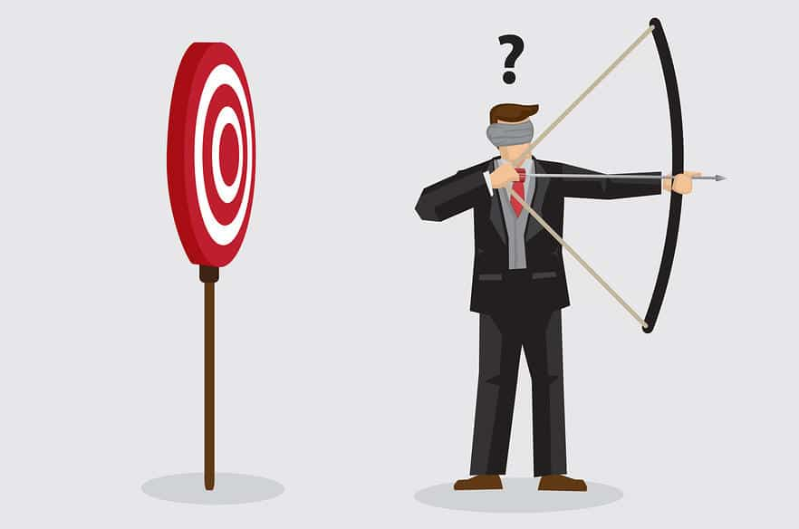 Drawing of man shooting an arrow in the opposite direction of a target