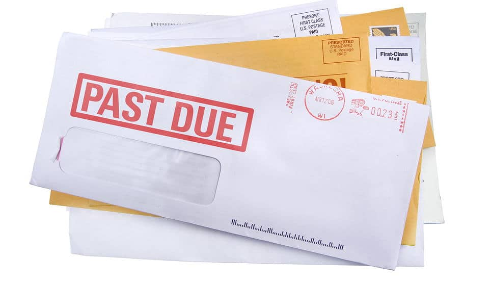 envelopes with notice 'past due' on them