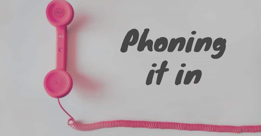 """Picture of a pink phone and phone cord with the words """"phone it in"""""""