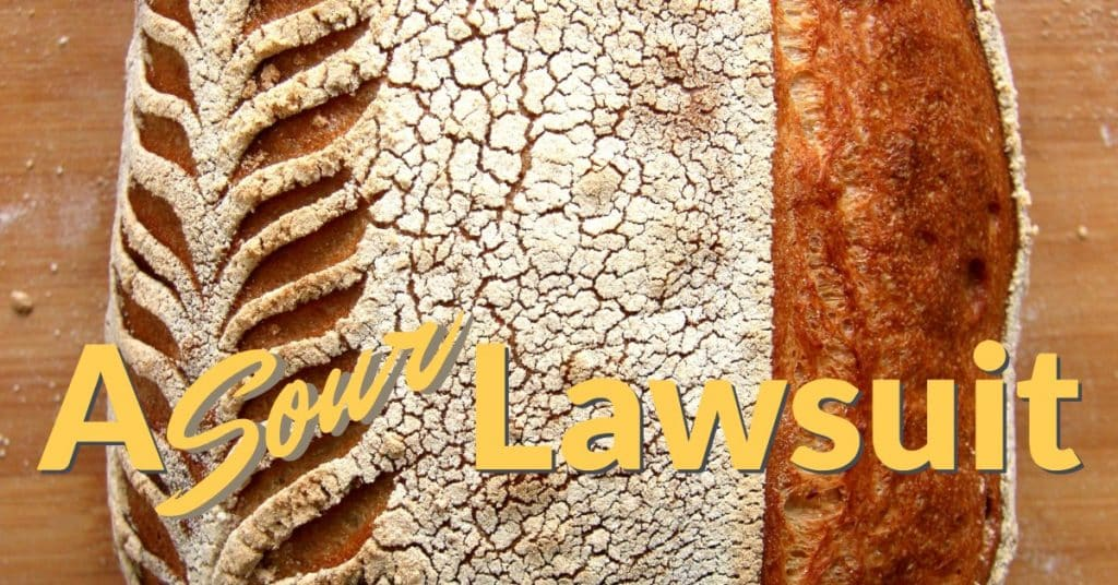 "A picture of a loaf of sourdough with the words ""A Sour Lawsuit"""