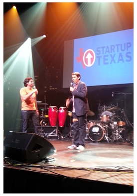 .Co founder Juan Diego Calle on stage with Steve Case.