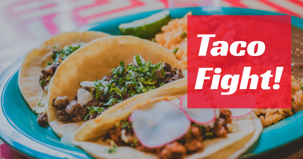 "A picture of a plate of tacos with the words ""Taco Fight!"""