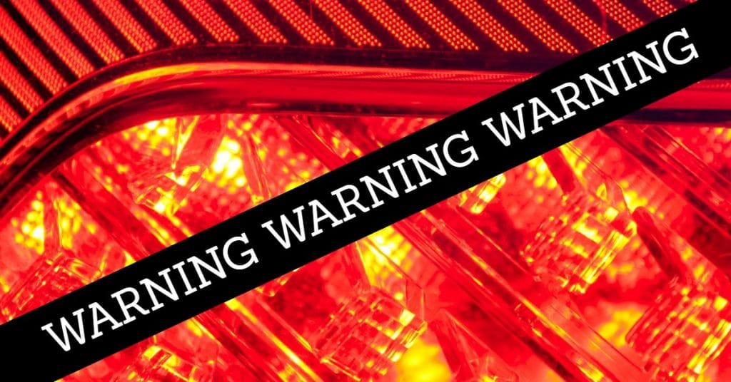 "Picture of flashing light with the word ""warning"" repeated three times across a black box"